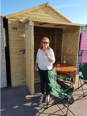 Pamela Jones outside the Bay Lodge Beach Hut 101
